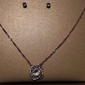 Pendant on a chain and matching earrings